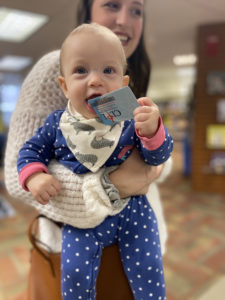 baby eating a library card