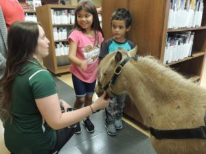 Kids learning about therapy horses.